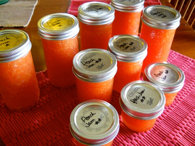 mason jars of peach jam with handwritten labels